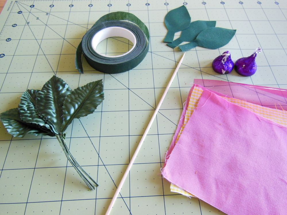 I cut out some green leaves out of fabric, which worked well when I ran out of pre-made ones.
