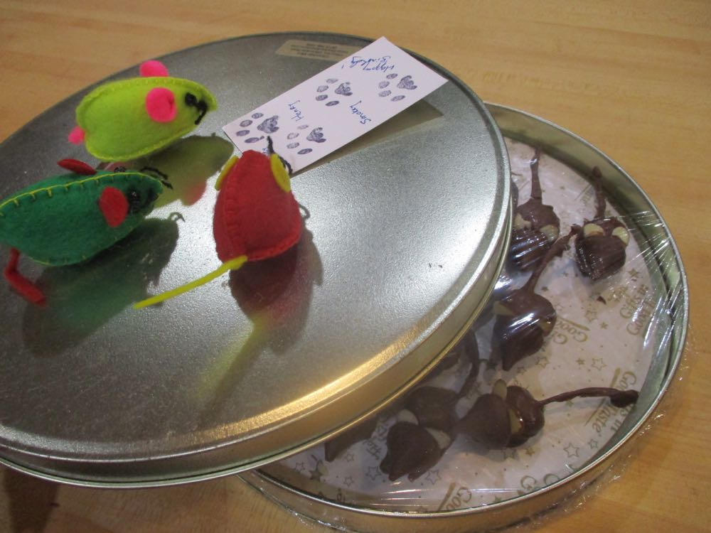 Photo 2:  Package chocolate mice in a tin container to keep the almond ears from breaking and add toy mice on top instead of a ribbon for a feline treat. (Photos by Charlotte Ekker Wiggins)