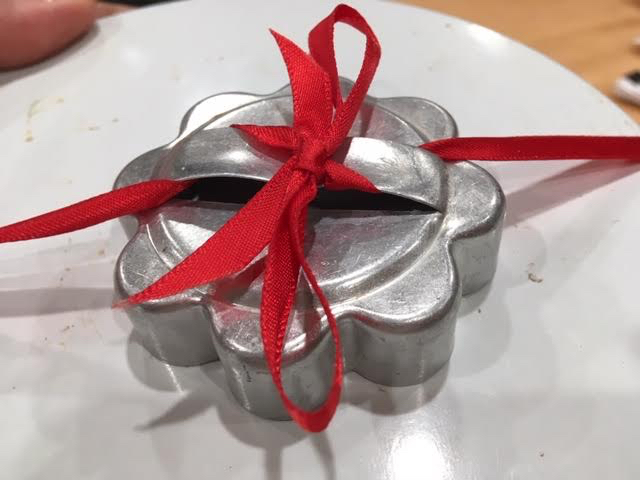 Easily turn a cookie cutter into a gift box bow using a small ribbon. (Photo by Charlotte Ekker Wiggins)
