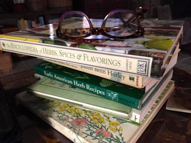 The start of my winter reading stack has a decided theme - herbs. (Photo by Charlotte Ekker Wiggins)