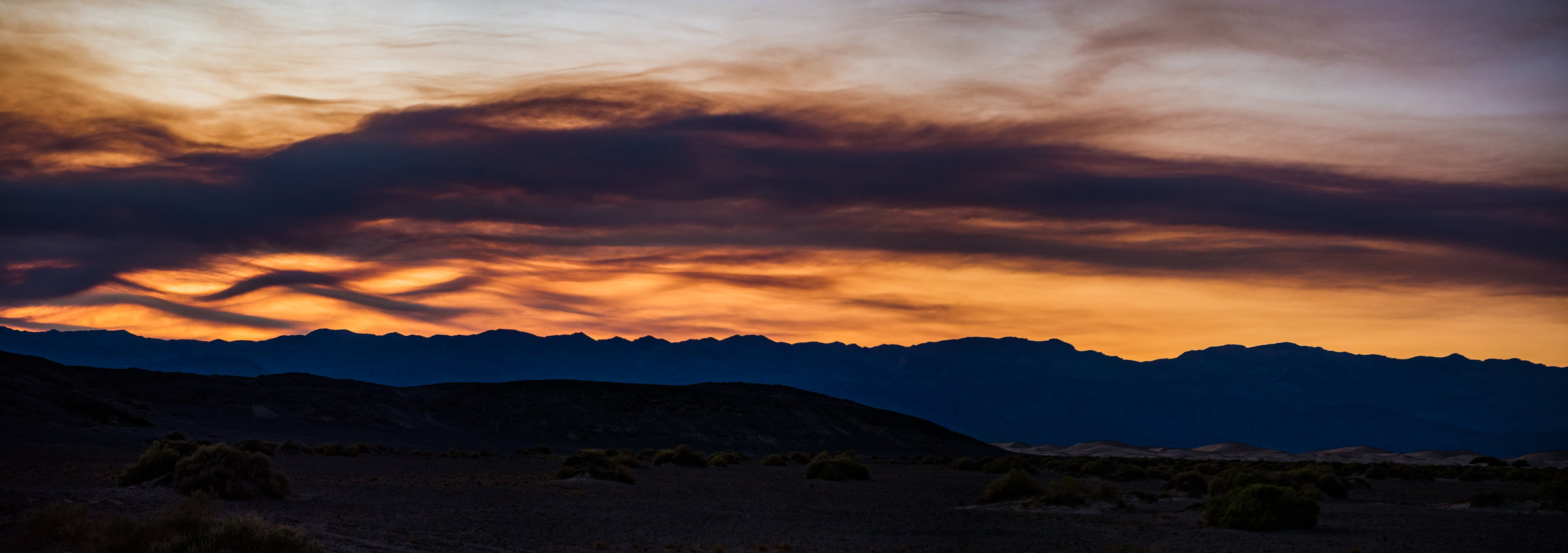 Sunset coming through Death Valley the night before our recent adventures
