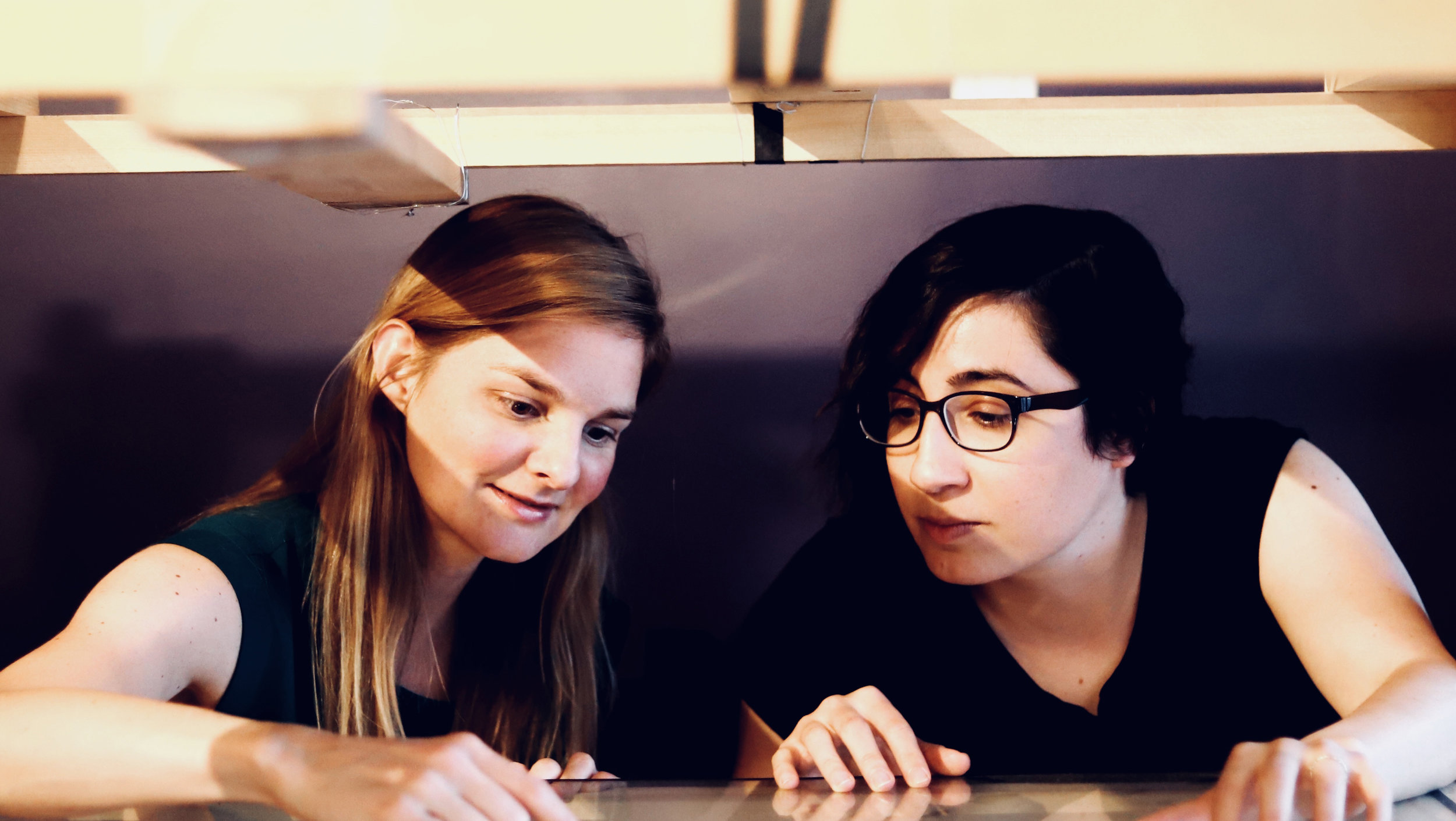 Elizabeth Beecherl and Carla Patullo working on Trick Studio's multiplane camera.