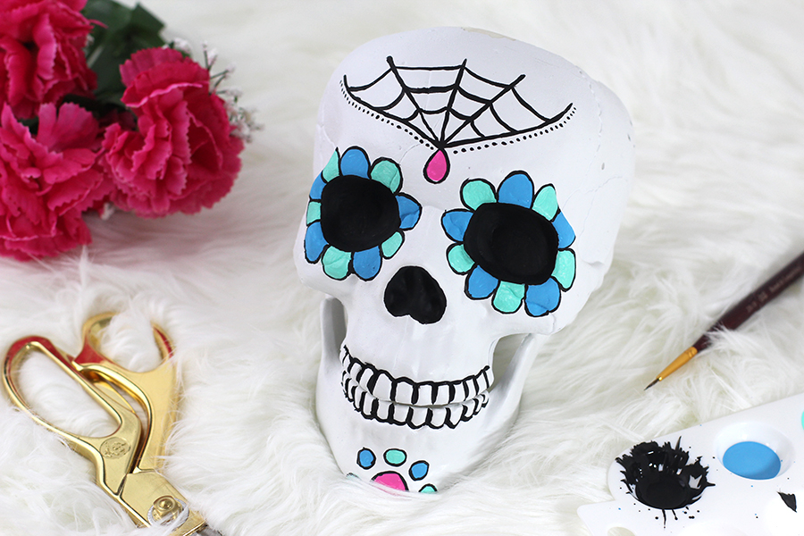 Have fun, add shapes and color to your sugar skull candy.