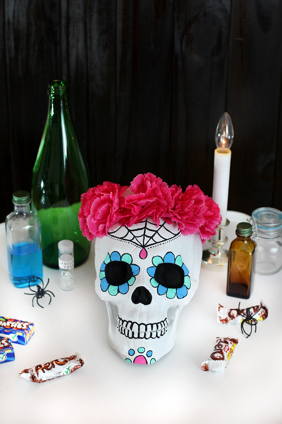 The complete Halloween sugar skull candy bowl. A super fun craft for Halloween. Click through for tutorial.