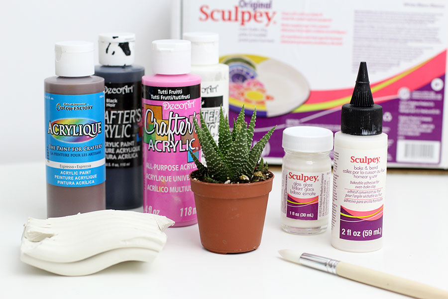 Materials to make polymer clay animal head succulent planter with clay.