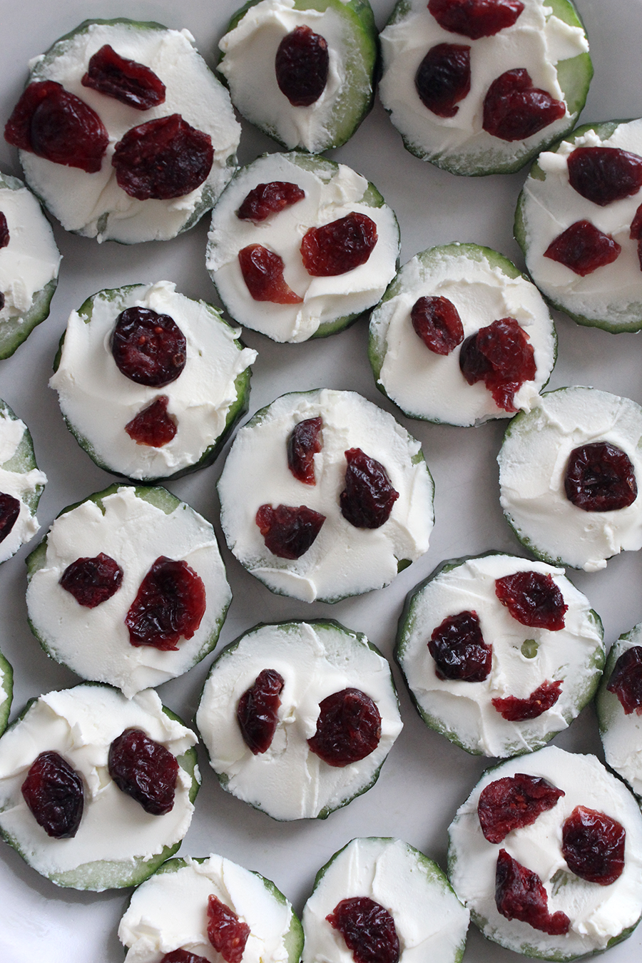 Cucumber cream cheese and dried cranberries appetizer idea for parties or snacks.