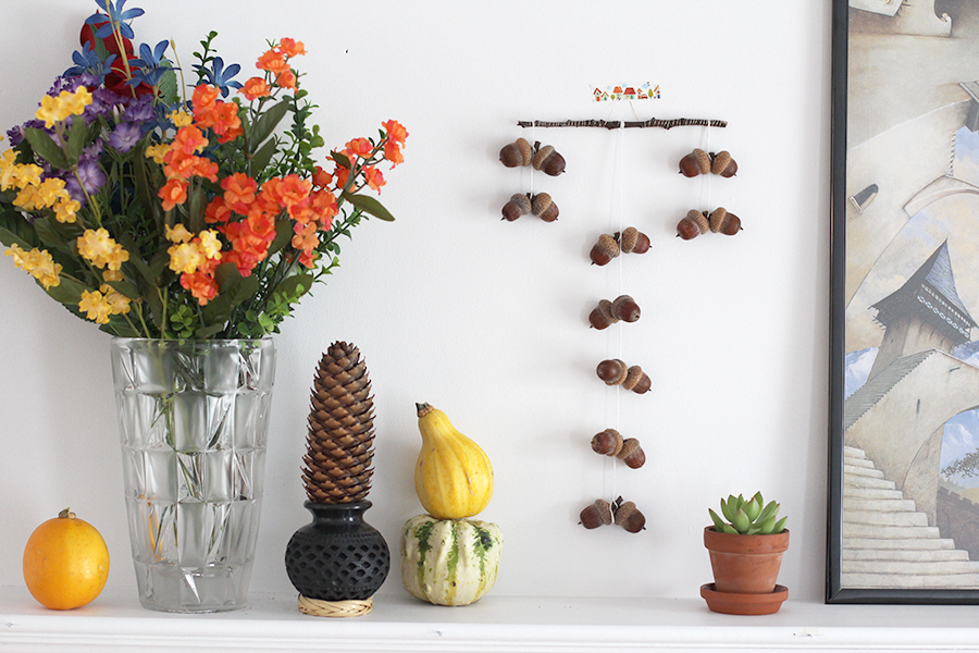 A super cute fall acorn mobile to decorate your fire mantle.