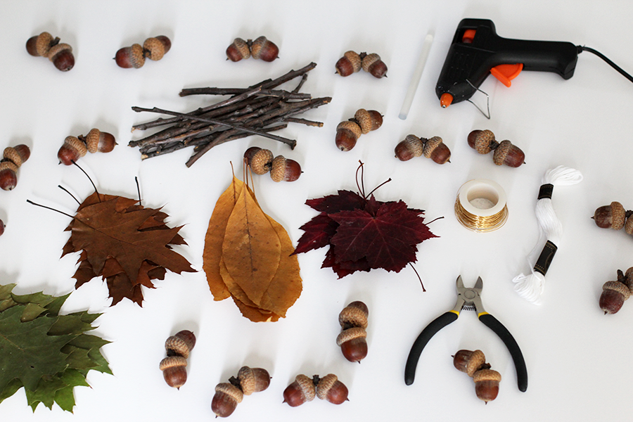 Fall gatherings for garland materials: leaves, acorns, branches, string, glue gun and wire.