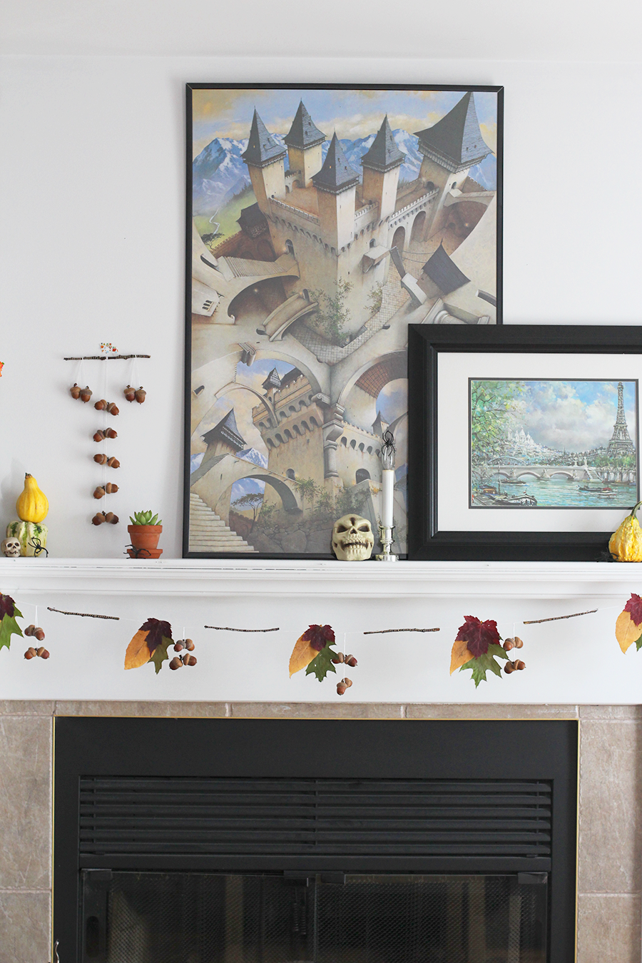 Fall gatherings garland with colored dried leaves, acorns and branches.
