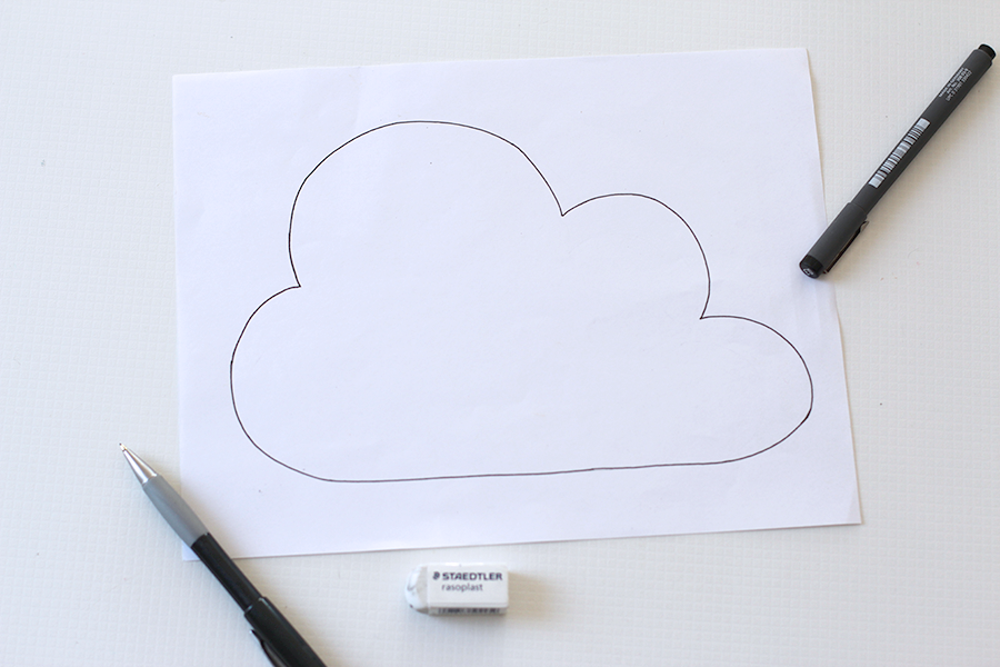 Draw cloud stencil on paper.