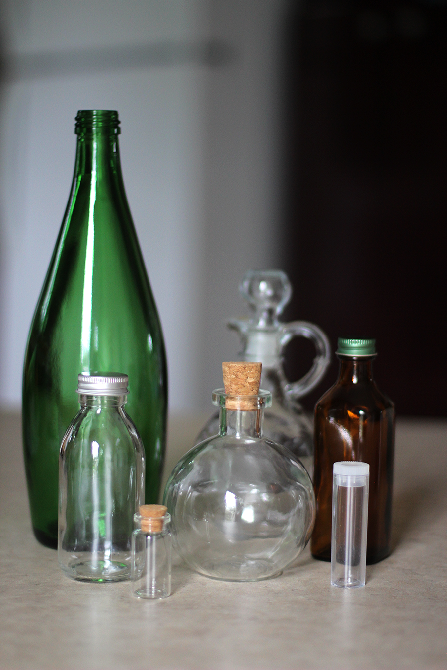 Glass bottle collection for Halloween apothecary.