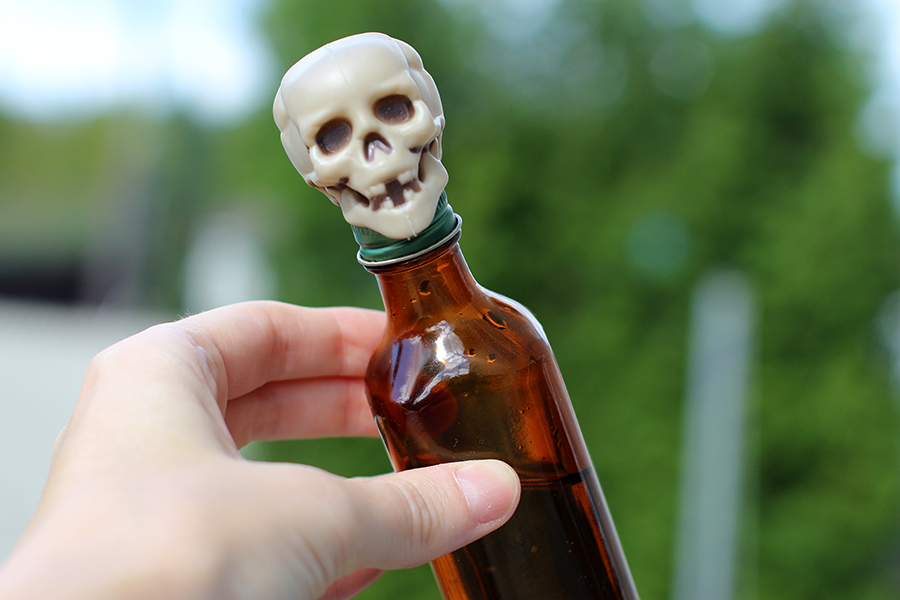 Add plastic skull to poison bottle: death imminent!
