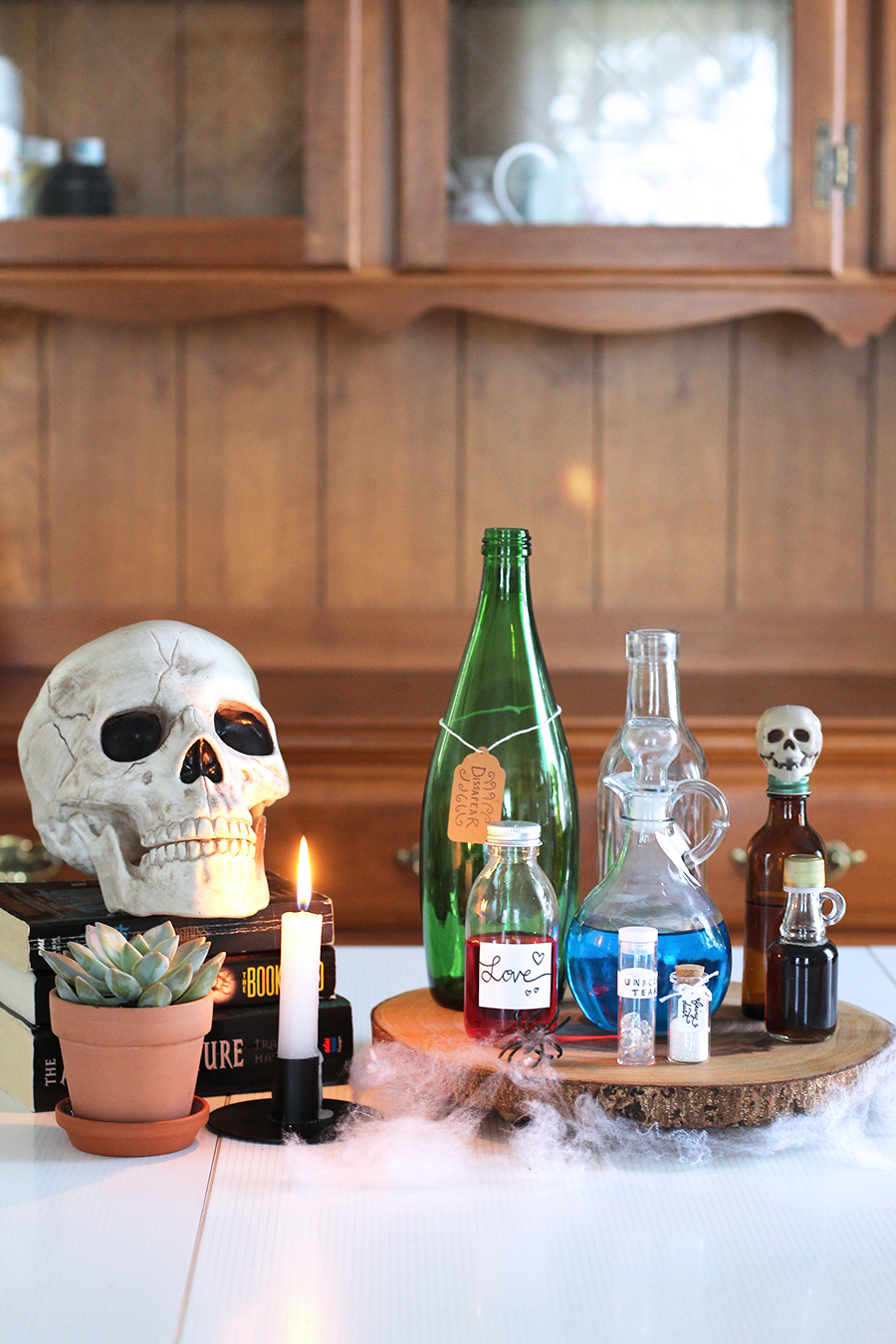 A super cute and fun Halloween apothecary DIY; poison, love & flying potions, unicorn tears, fairy dust, disappearing air... anything goes! Click through for tutorial.