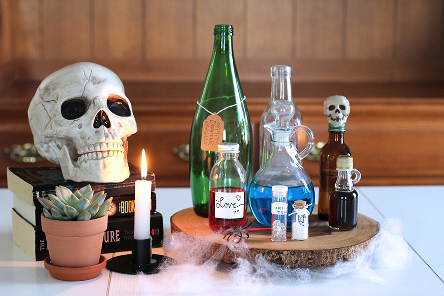 A super cute and fun Halloween apothecary DIY; poison, love & flying potions, unicorn tears, fairy dust, disappearing air! Click through for tutorial.
