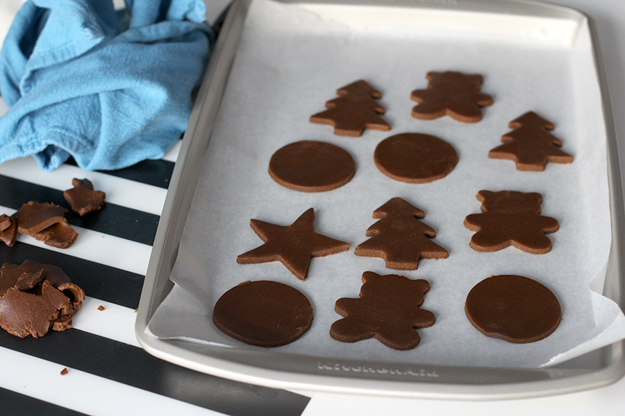 Place the cut shapes of egg free gingerbread cookie dough on a baking tray.