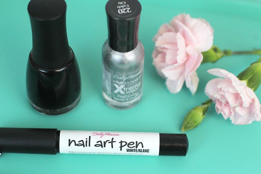 Materials for black on silver nail art; black and silver nail polish, white nail art pen, top coat polish.