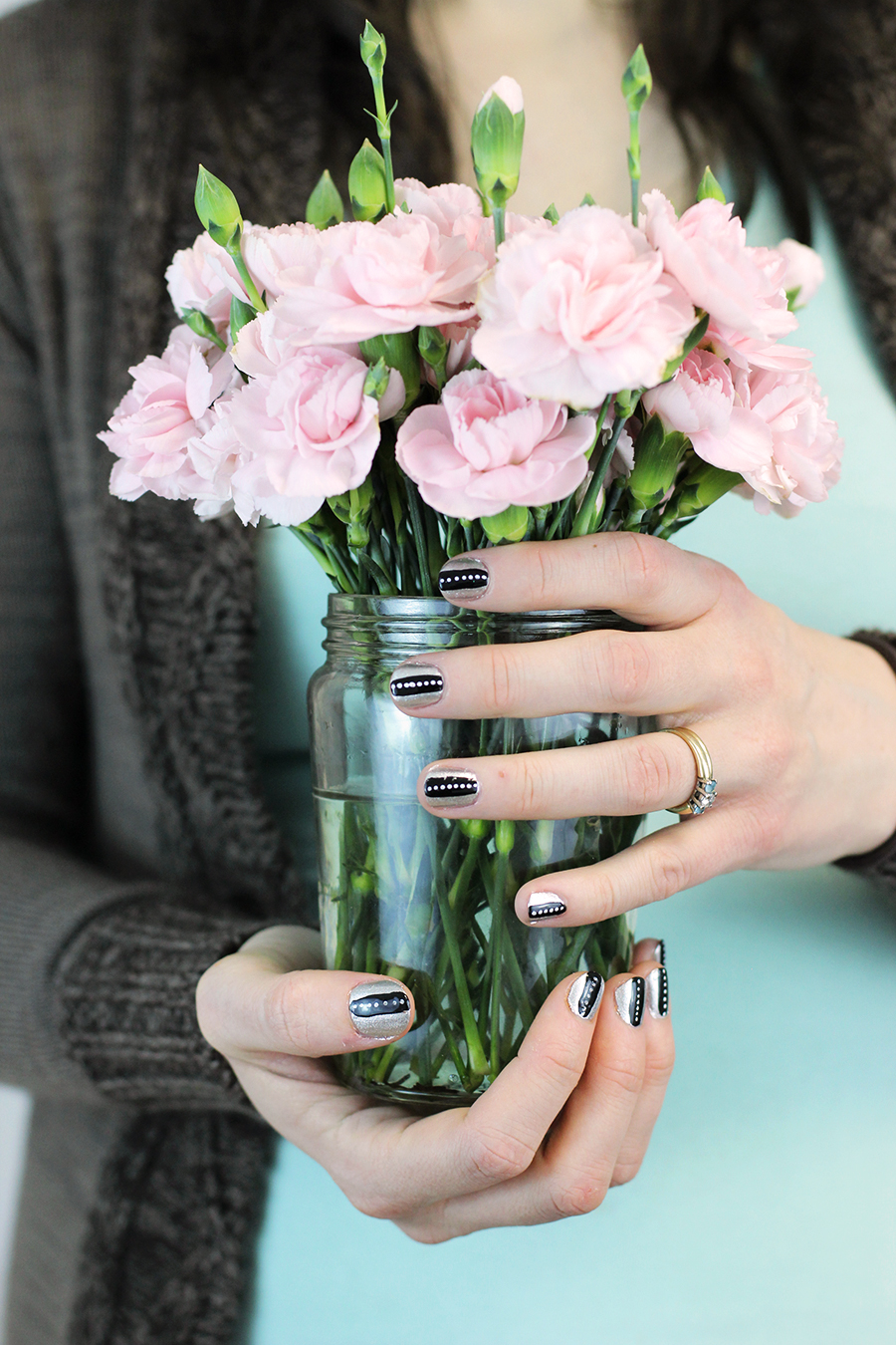 Pretty nail art. Super simple, thick black lines over silver base coat with little white dots. A fun afternoon mommy date activity. Click through for tutorial.