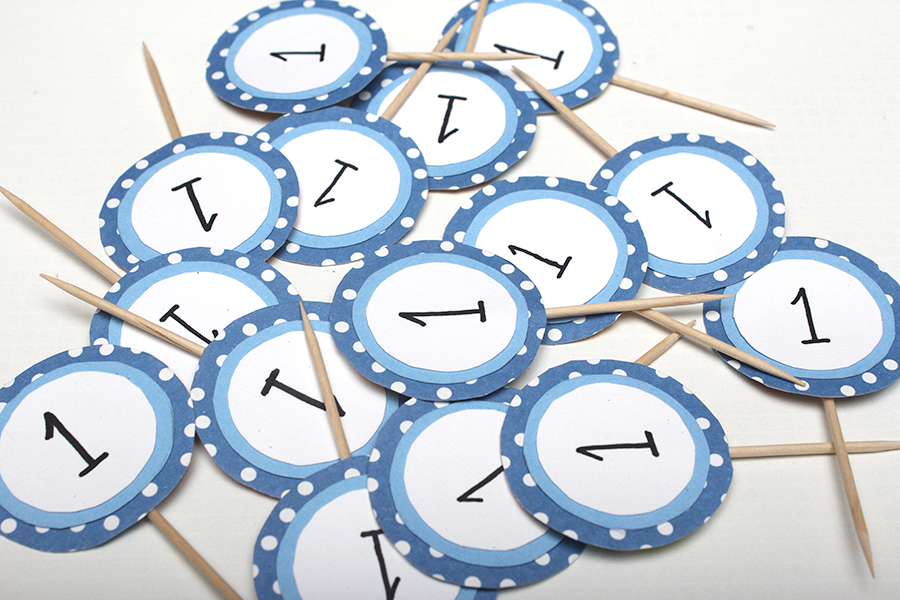 lots of blue and white circle 1 year old cupcake toppers.png