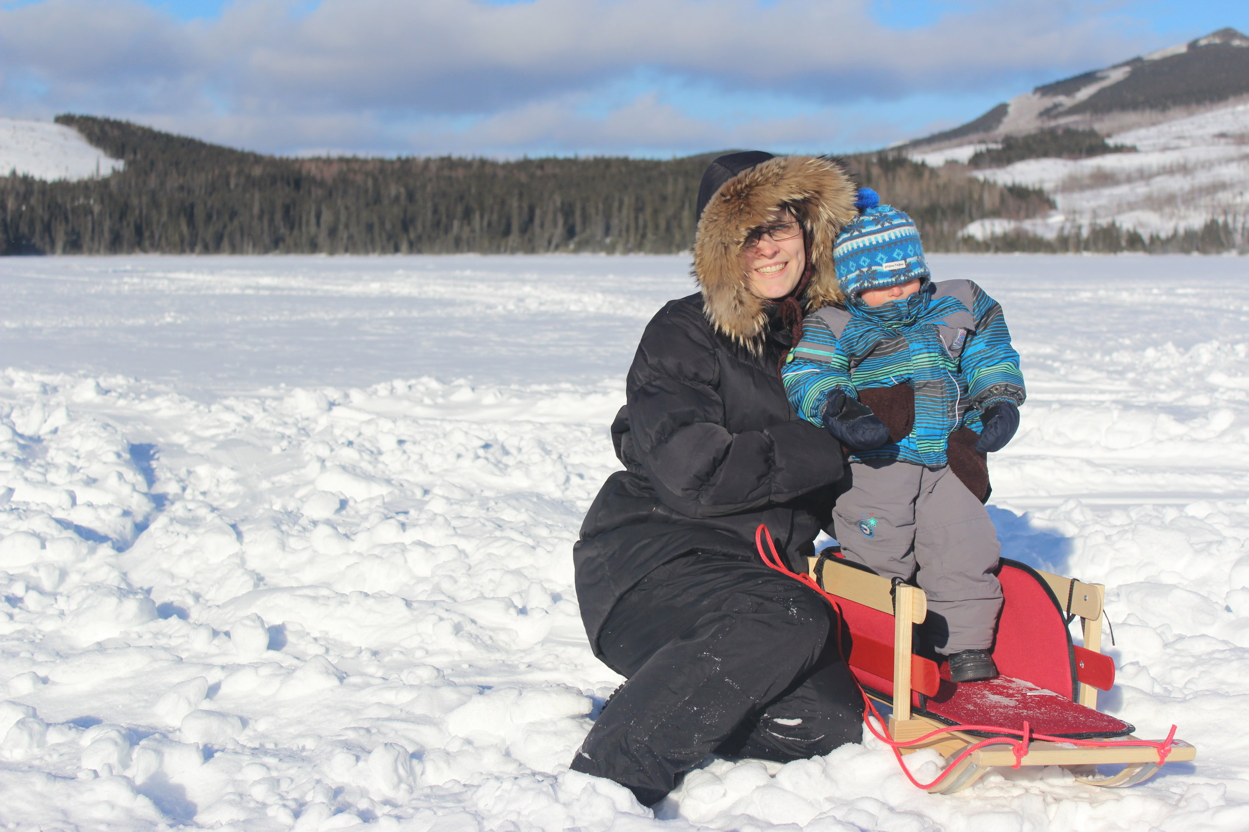 mom and son on frozen snowy lake.JPG