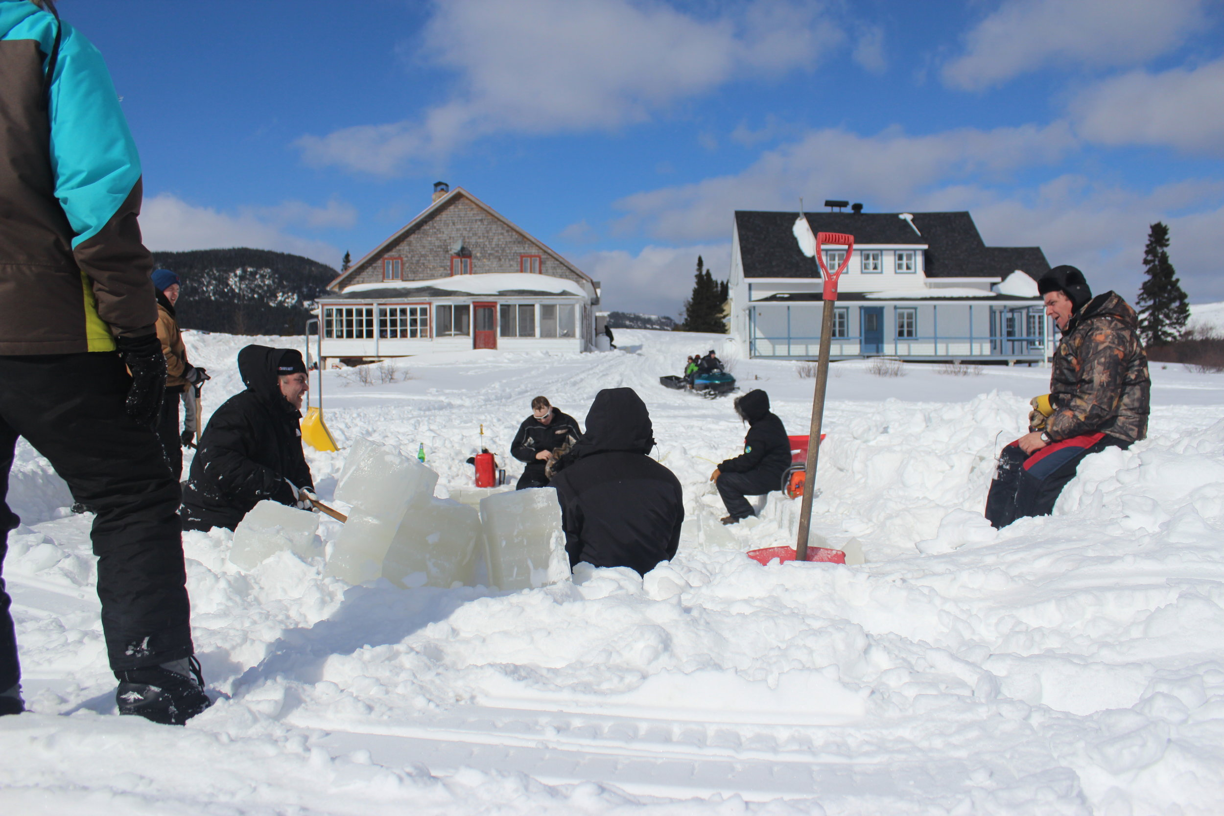 cutting ice blocks from frozen lake for ice house.JPG