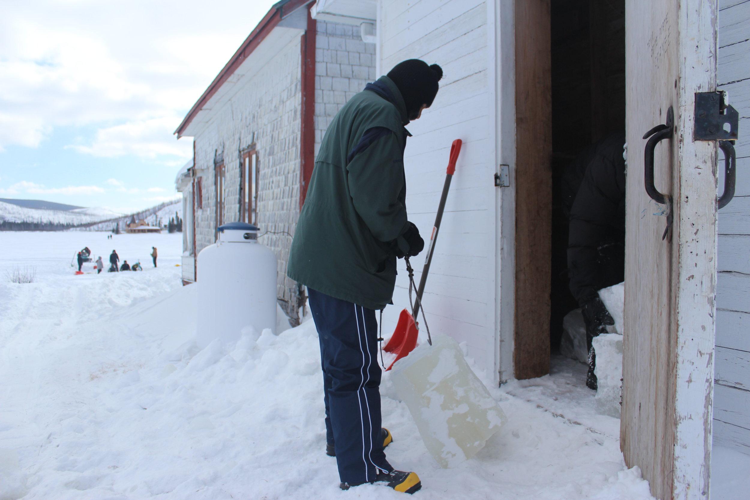 putting ice blocks in ice house.JPG
