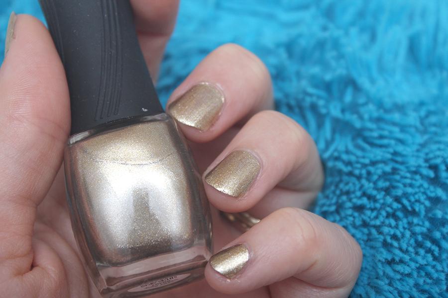 gold nail polish.png
