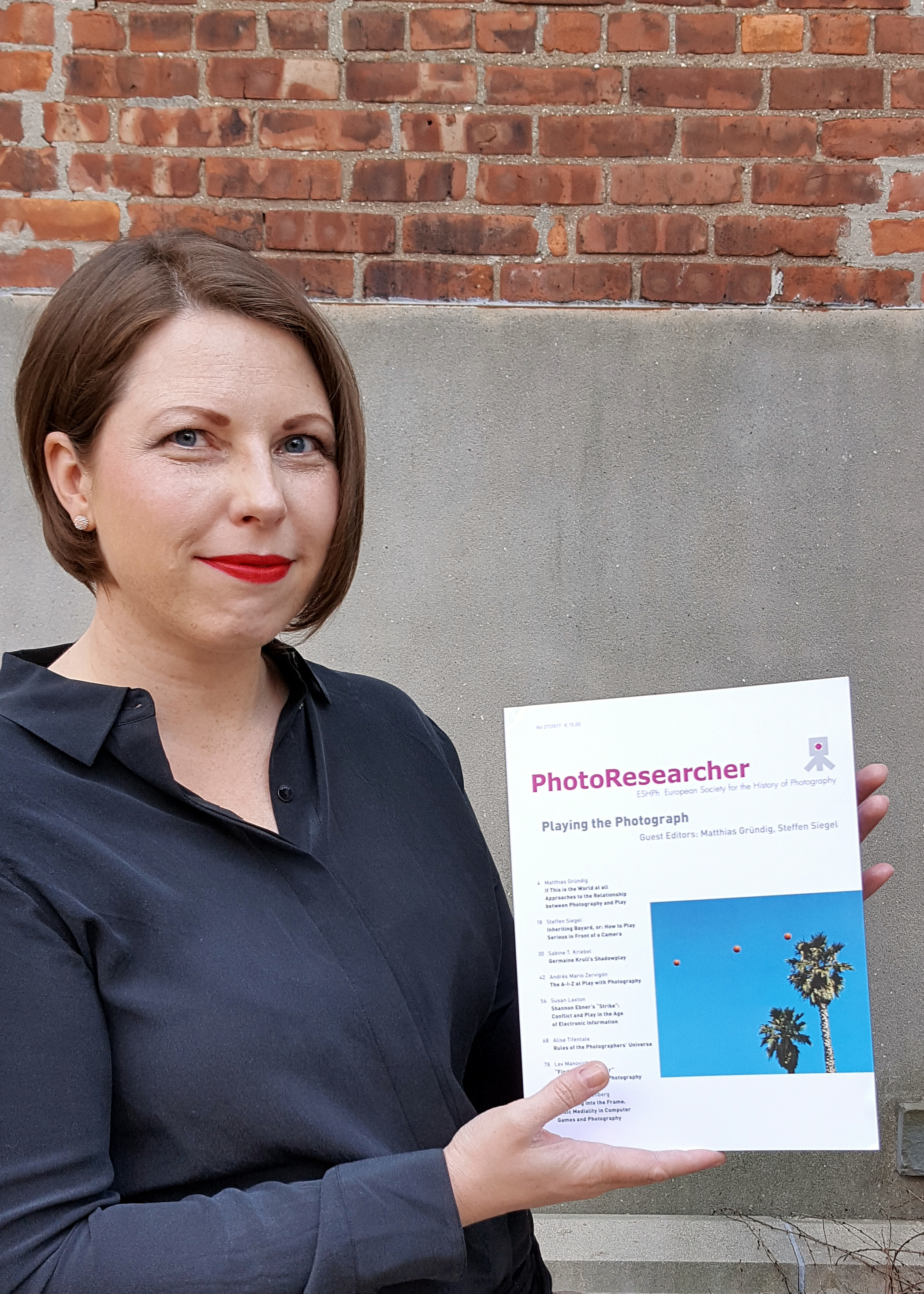 """Alise Tifentale with the  April 2017 issue of Photoresearcher    which features article """" Rules of the Photographers' Universe ."""" Photo: Hon Sun Lam."""