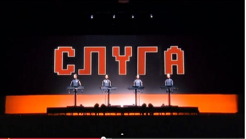Kraftwerk  performing live  Die Roboter , a single from their album  Die Mensch-Maschine  (1978) in 2004. Screenshot from YouTube.