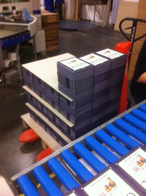 Books stacked ready for packing in boxes.jpg