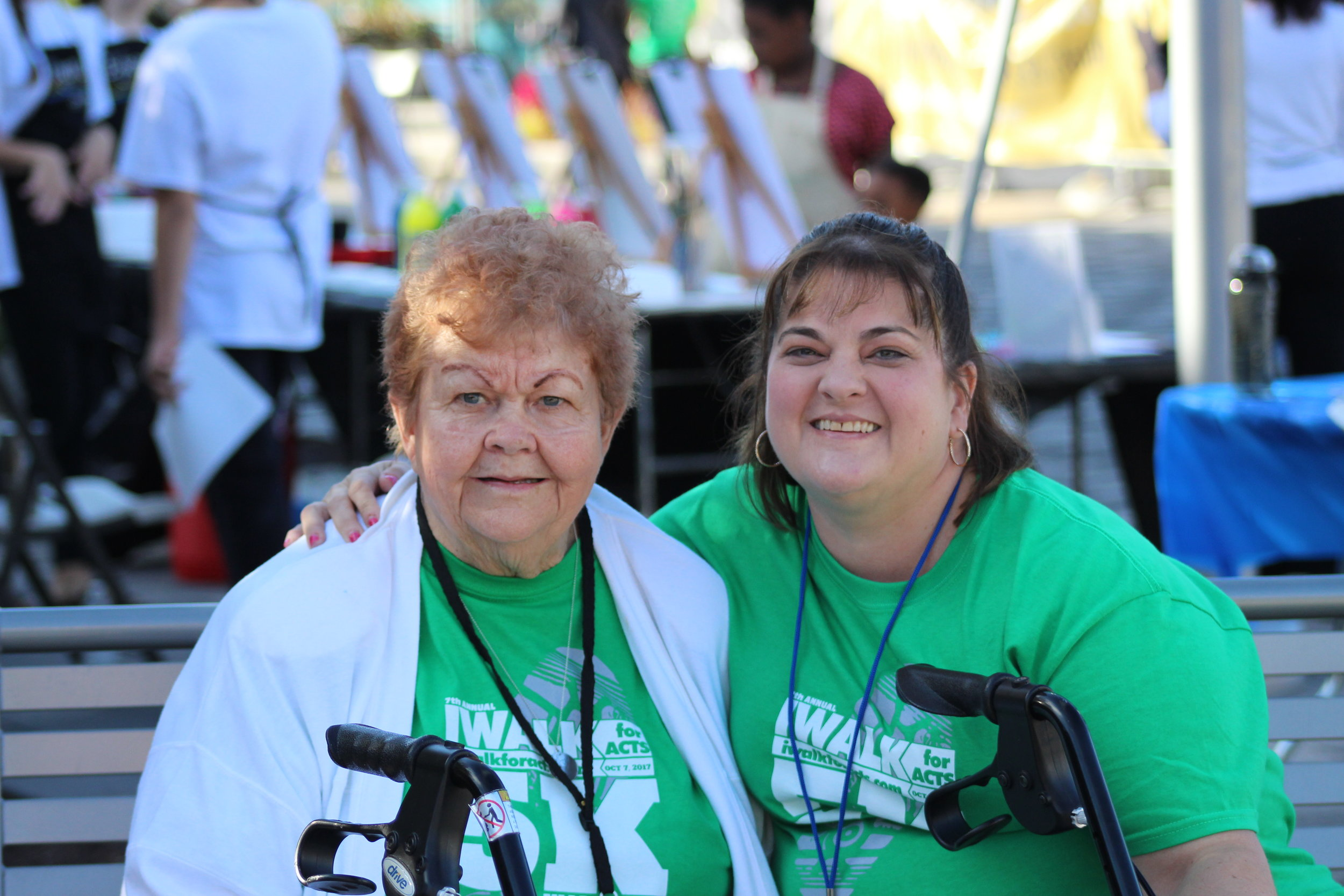 Image Church members Sherry Rickard (right) and her mother Betty Gonzalez volunteering at IWALK for ACTS in October