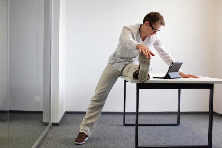 stretch at desk Dollarphotoclub_60654797 small.jpeg