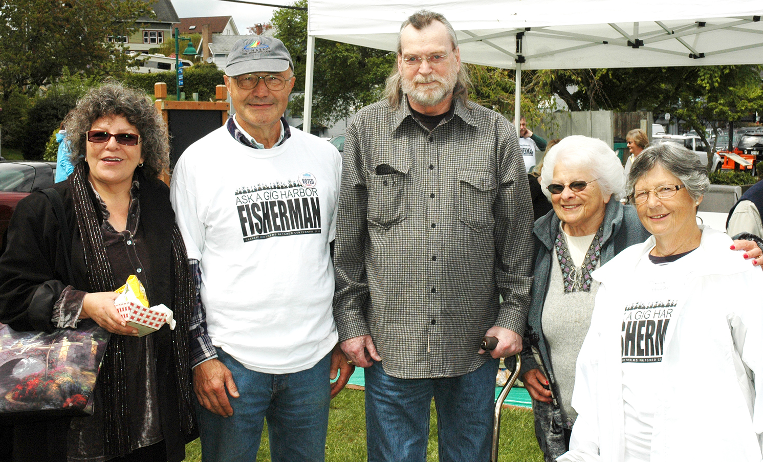 Mike Skansie's wife, Lydia, Mayor Chuck Hunter, Mike Skansie (son of Peter), Gretchen Wilbert, and Dianne Hunter during the 2010 100-year celebration at the Skansie Netshed.