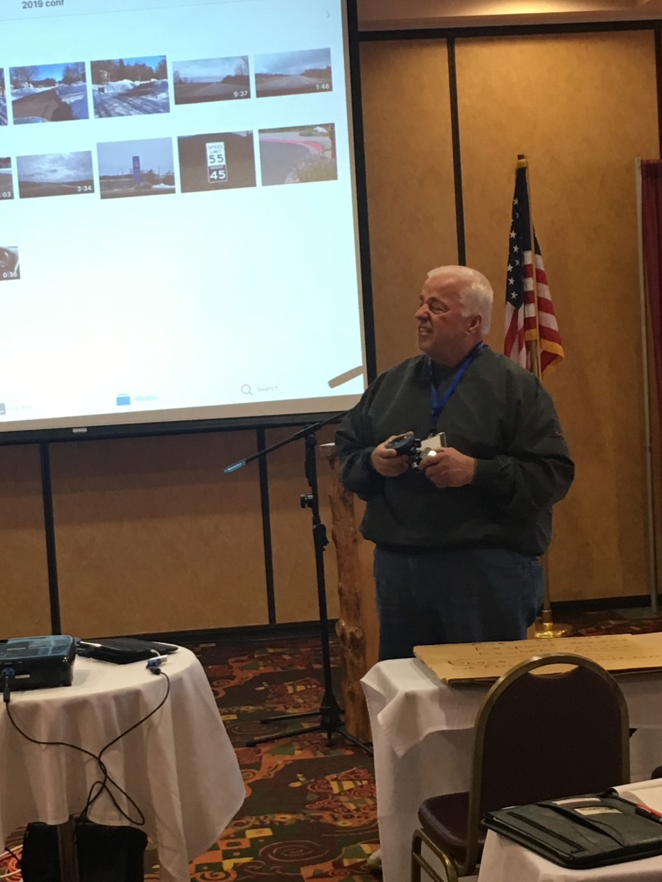 Teacher Jim Giese grimaces as he presents his topic of using in car cameras to record   driving situations that he may then show his classroom students.