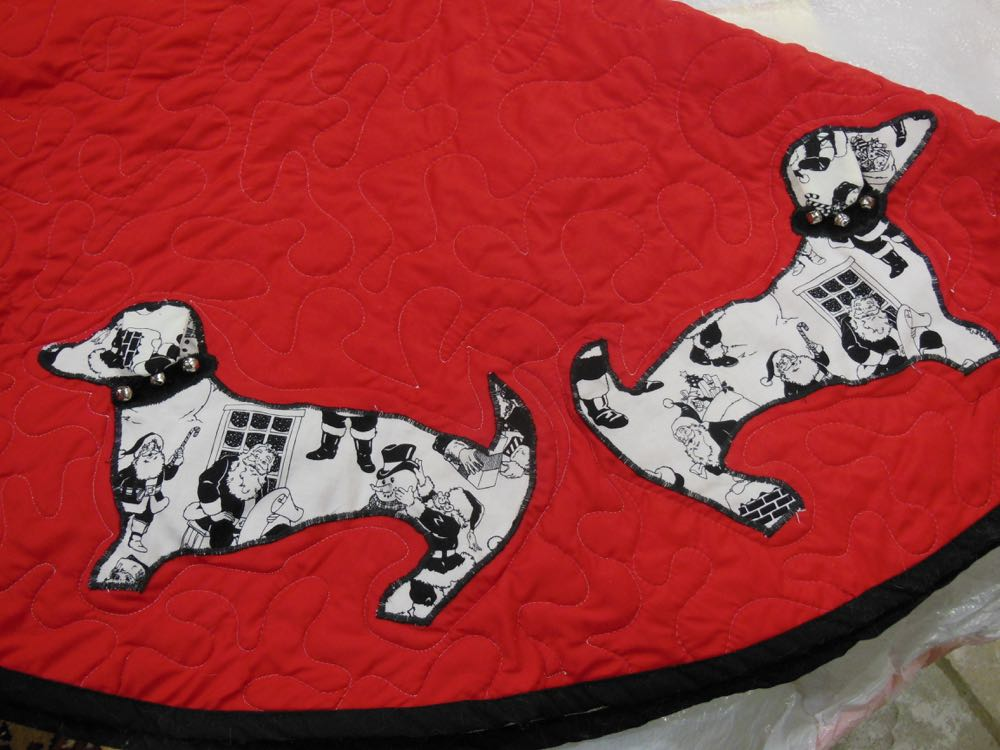 Two Bluebird Gardens custom vintage fabric doxie tree skirt dogs with silver bells.