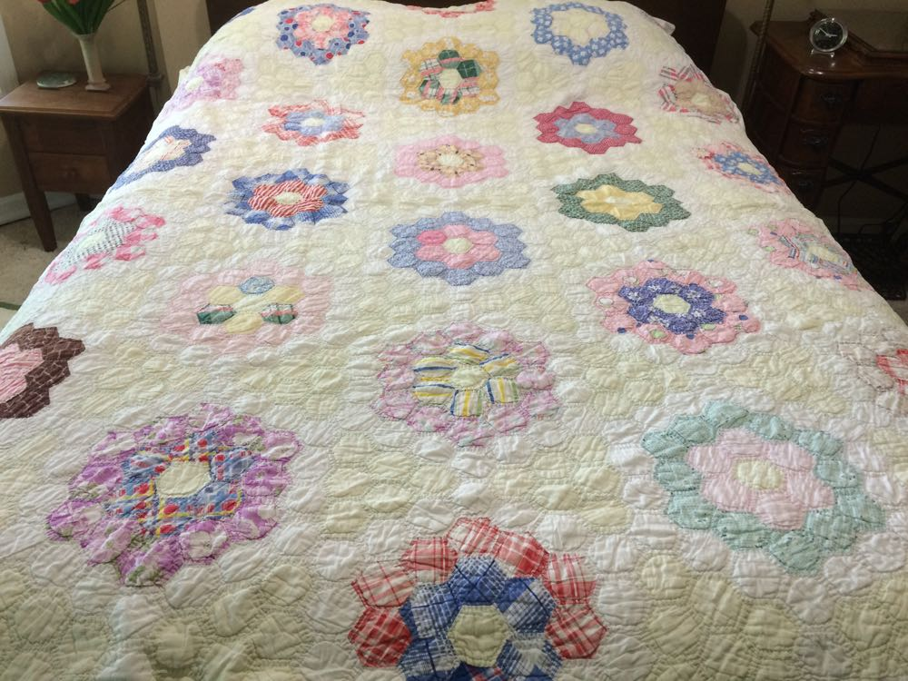 Isn't this a pretty version of the traditional Grandma's Flower Garden quilt?