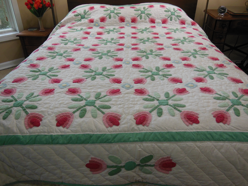 Pink Applique Tulips Quilt from The Williamsburg Collection hints at the history of the pattern.