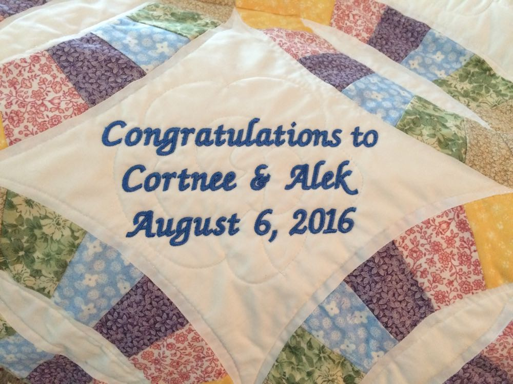 Personalize your quilt of choice with custom embroidery of the couple's name and wedding date.