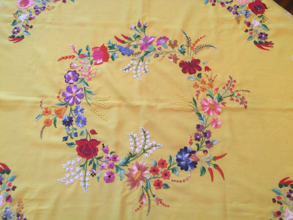 The center design of this hand-embroidered table cloth.
