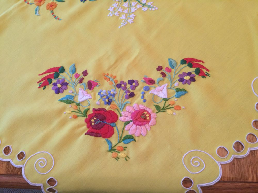 The corner of this square, handmade and hand-embroidered table cloth.eD
