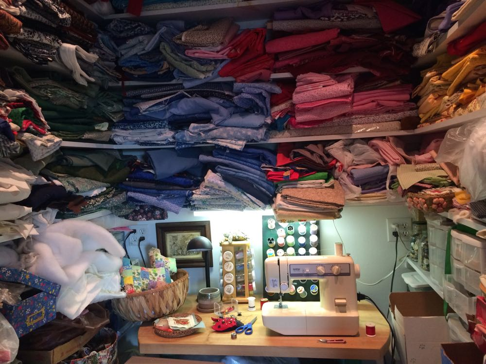 Bluebird Gardens fabric stash and sewing room is in a deep closet with folding doors.