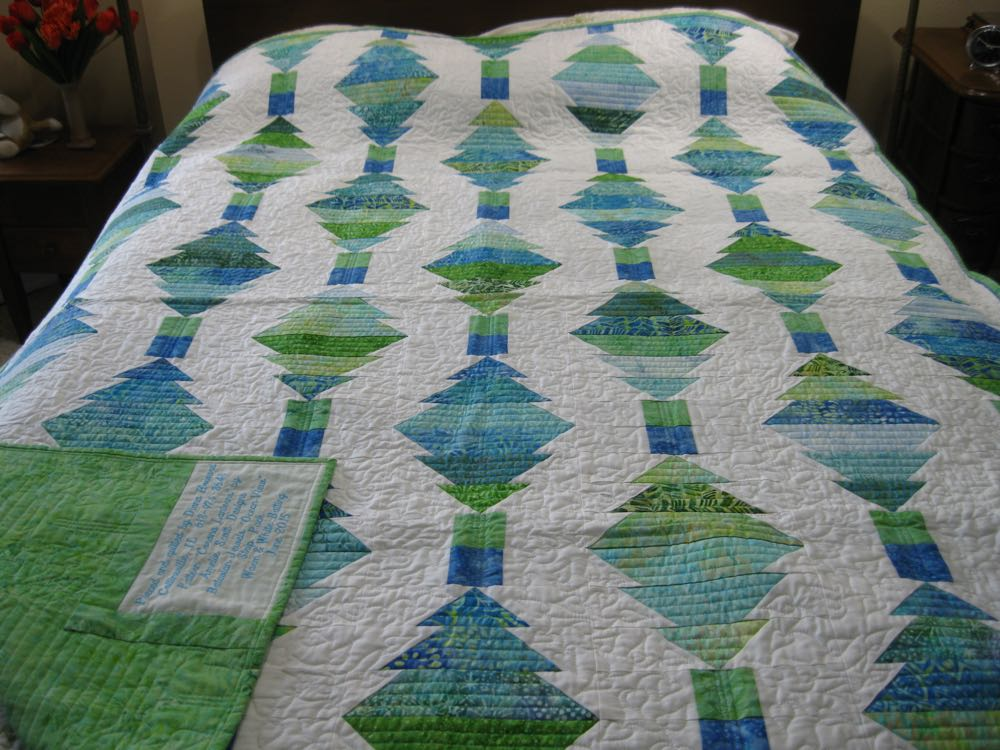 Corona Lanterns is a lovely lap quilt and throw with beautiful ocean green and blue fabrics.
