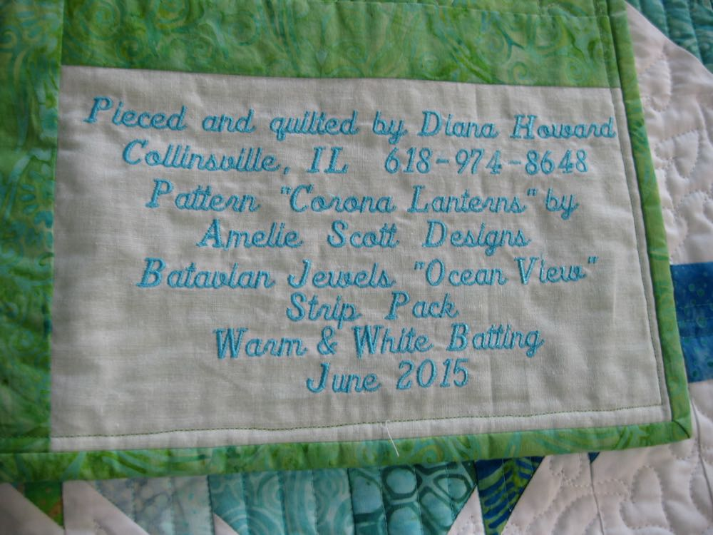 A detailed embroidered label on the back gives you full details of quilt materials.