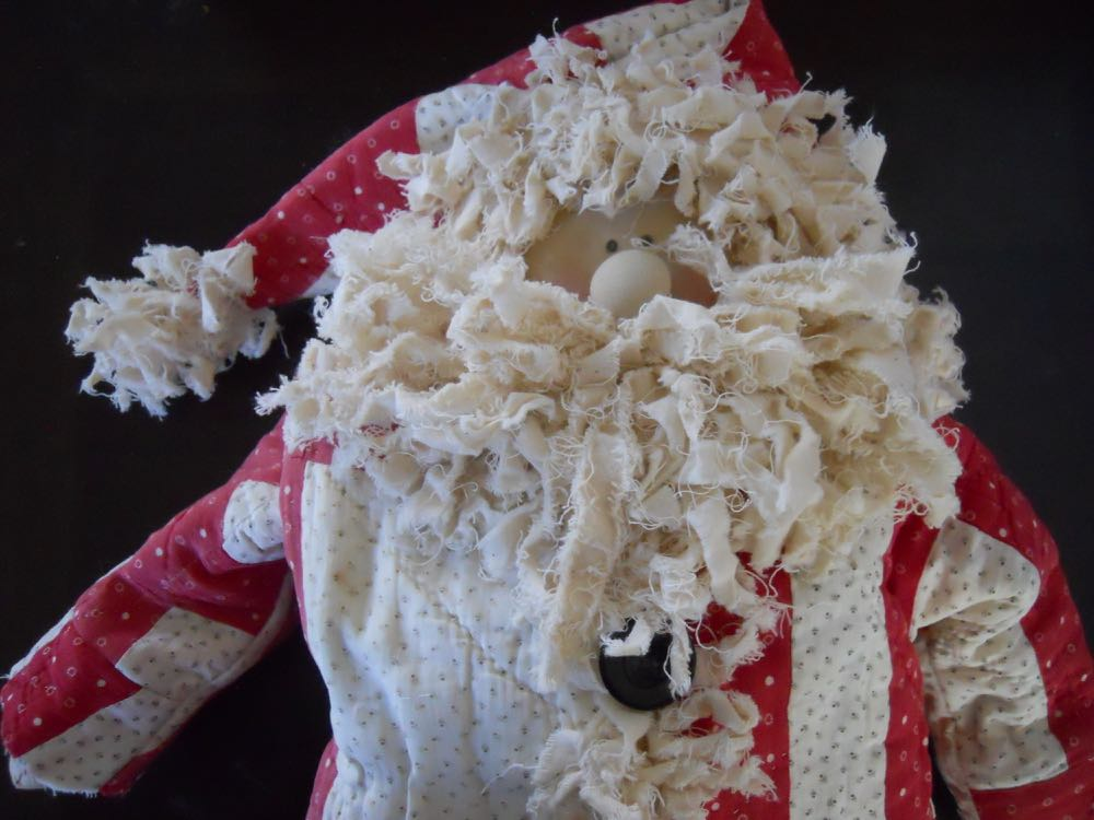 One of a kind Red and White Old Quilt Santa Claus doll ready to sit on your mantle.