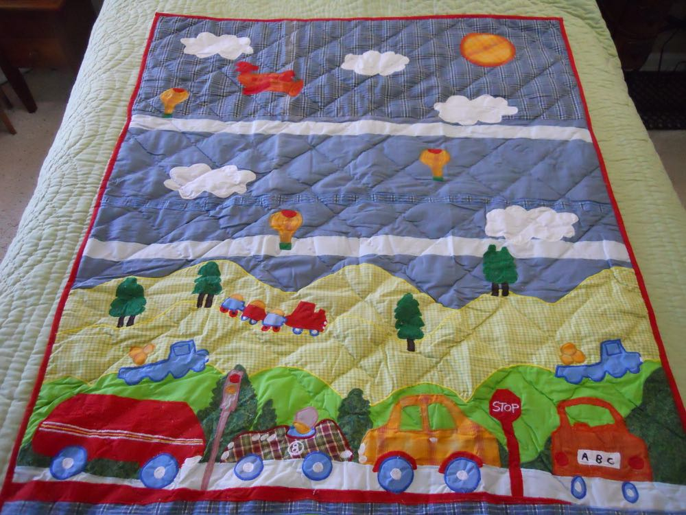 City Living Applique Baby Crib Quilt would work well as a nursery wall hanging.