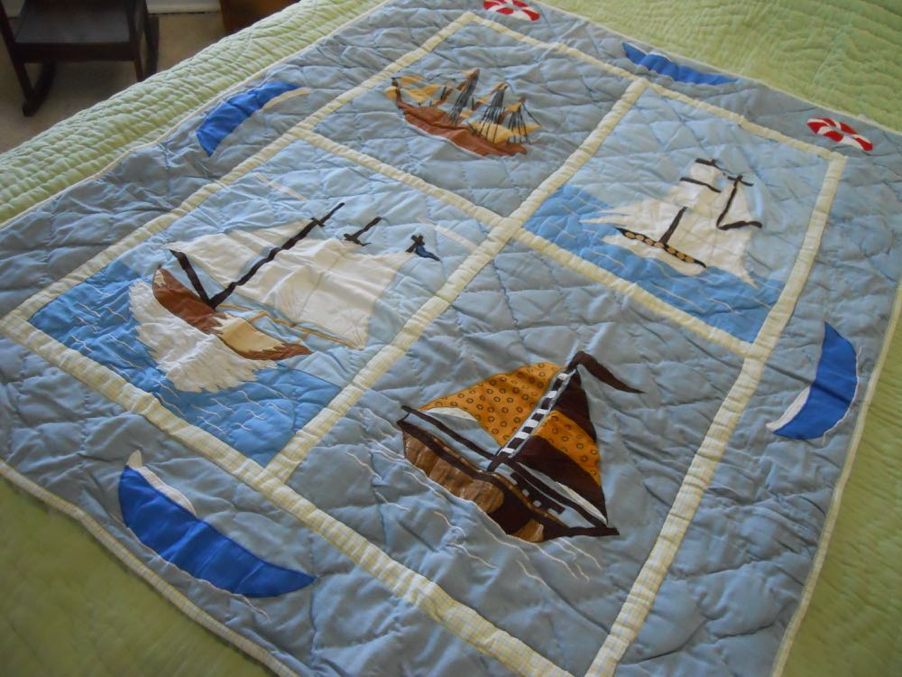 This elegant 36x48-inch nautical-themed baby crib quilt will make a nice wall hanging.