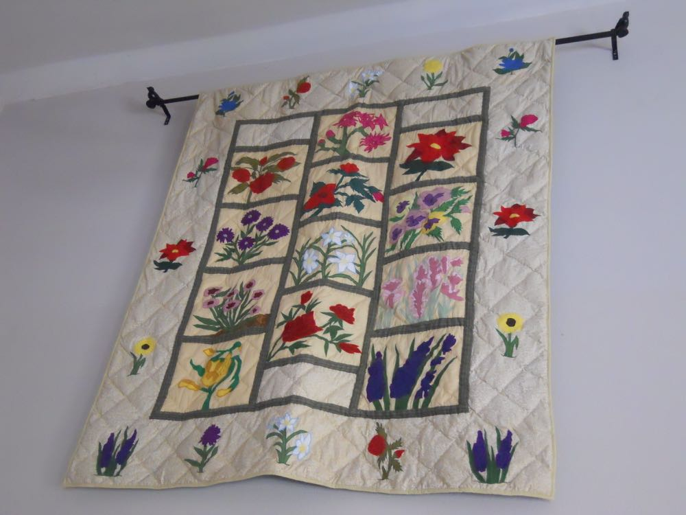 Wildflowers Lap Quilt Throw works very nicely as a quilted wall hanging.