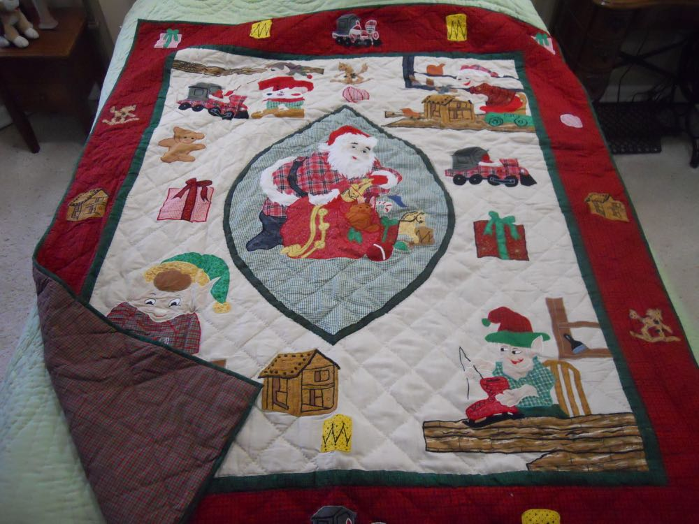 Santa's Workshop Quilt throw wall hanging quickly turns any room into a very busy place!