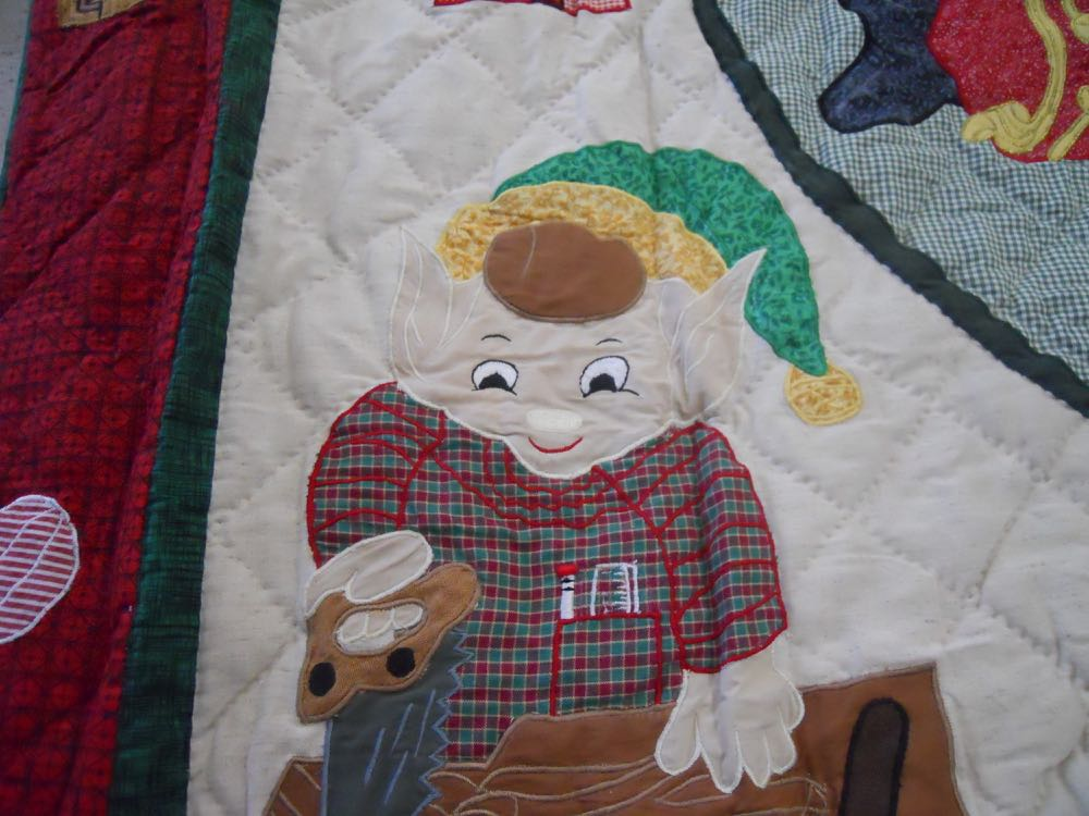 This elf is wood-working in santa's workshop quilt throw all hanging, love the ruler in his pocket.