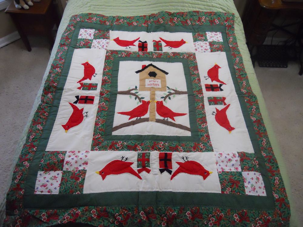 Happy Holidays Cardinals Quilt Throw Wall Hanging nicely marries nature with the holidays.
