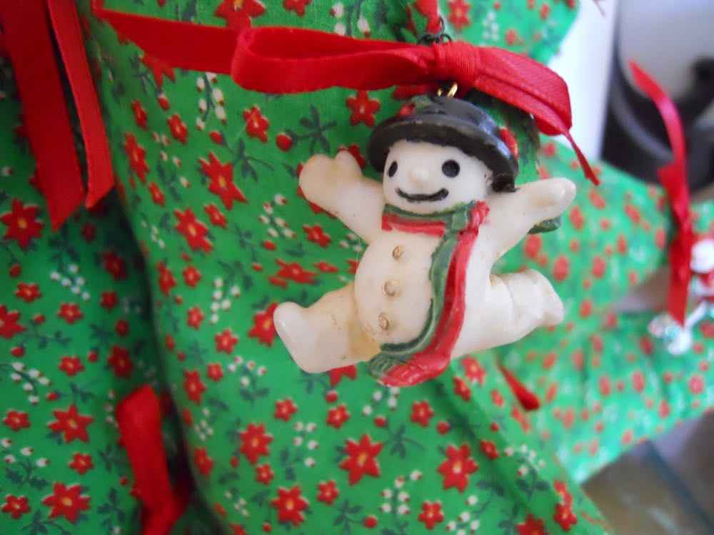 Also loved this little snowman ornament as if jumping across the fabric Christmas tree.